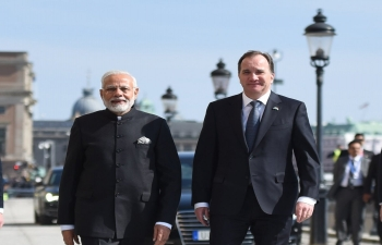 PM Narendra Modi takes a short walk with SwedishPM Stefan Löfven from Sager House to Rosenbad in Stockholm.